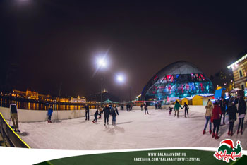 ice skaters at night at the Whale Advent festival