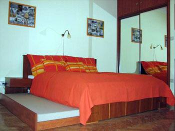 The single bedroom in Paprika Apt