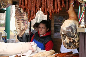 mangalica sausages and ham in a wooden booth on the Mangalica Festival