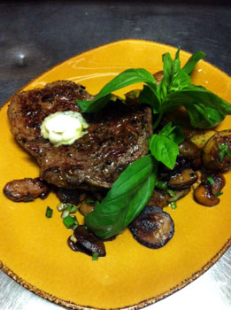 Angus steak with fried mushrooms in Trattoria Mamma