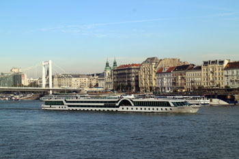 View of Elizabeth Bridge and a boat on the Danube
