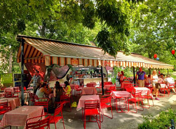 garden resturant with red and yellow striped tents