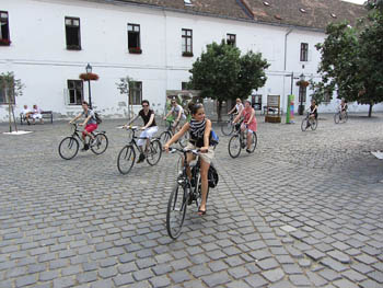 bikers on a cobbled stone square