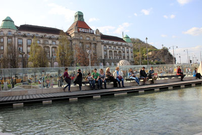 people at the small water fall at Szt. Gellert Sqr. metro station, Budapest
