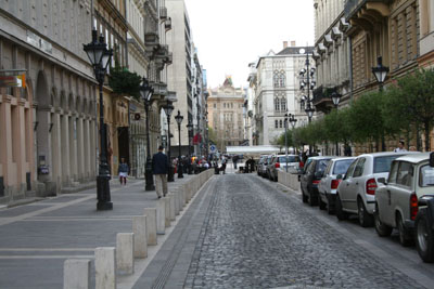 Hercegprímas utca with street lamps on one side and parking cars on the other side.