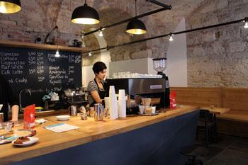 Andrea making cappuccino in Espresso Embassy