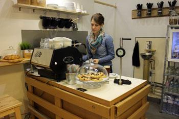Anna making flat white In Kontakt cafe