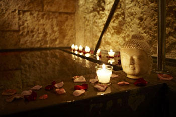 lighted candles in the BuddhAttitude spa