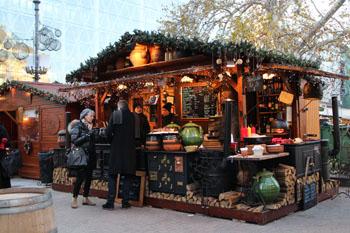 wooden stalls offering mulled wine and food-Vorosmarty sqr