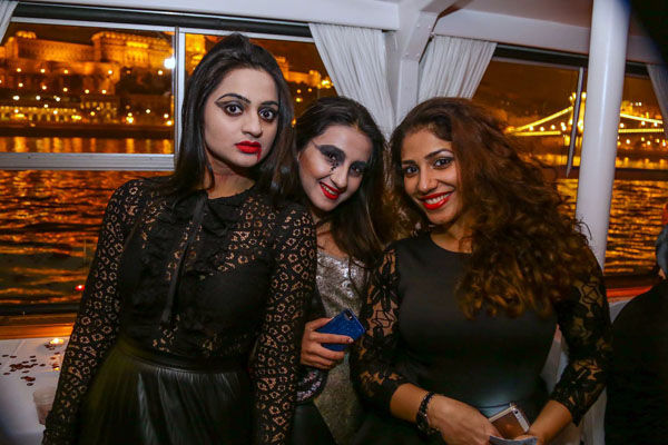 3 girls in Halloween costumes and make-up
