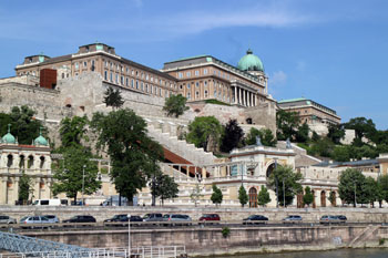 buildings of the Varkert Bazaar and the Royal Palace of Buda on photographed from a boat on a clear spring day