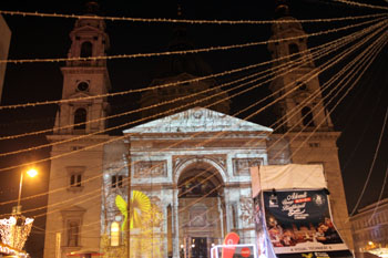 Colorful light painting on the facade of the Basilica