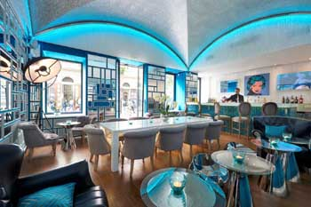 the lively blue decor of the bar