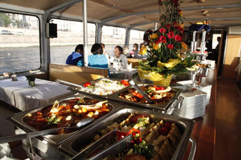 tourists having buffet lunch on a boat