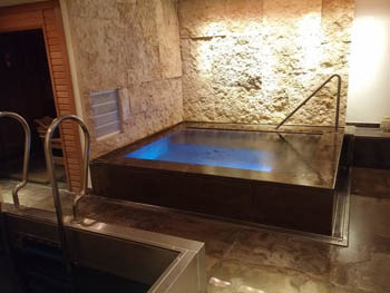 a small square indoor pool in the Spa
