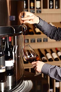 pouring wine from a wine tasting machine at CultiVini