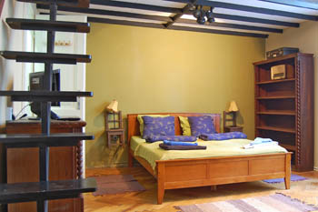 a bedromm with king size bed, warm colors