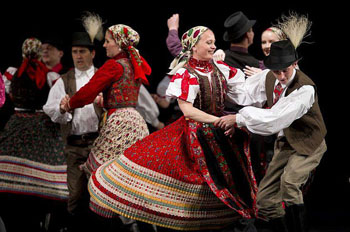 members of the Hungarian State Folk Ensemble dancing in traditional costume