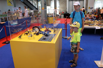 our 4-year old and 11 year old sons viewing Lego toys on the xhibit in 2015