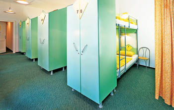 bunk bed and pale green lockers in the dorm