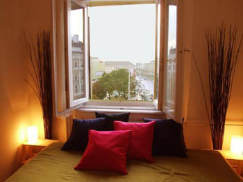 a room with a alarge open window overlooking the city