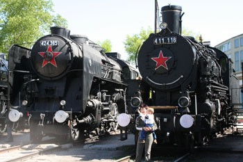 two black steam engines with a red Russian star on their front