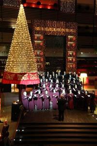 a golden Christmas tree in Sofitel Budapest's lobby