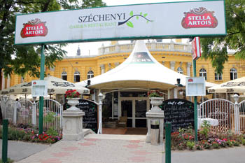 entrance to the restaurant, the yellow building of the Szecenyi bath in the background