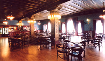 wood paneled interior of the cafe with the lights on