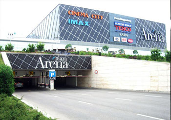 the facade of Arena Plaza with names of some shops on it