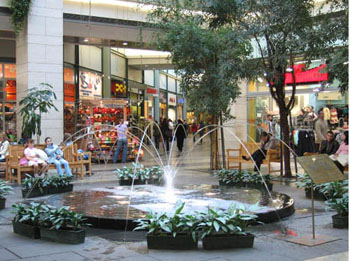 a fountain inside West End City Centre