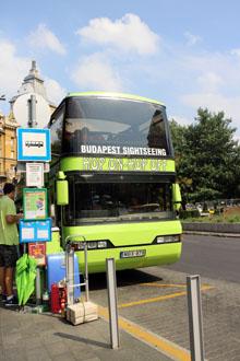 green double dekcer hop hop off bus on Erzsebet Square