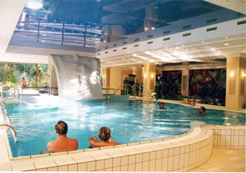 a middleaged couple in the indoor pool of the Danubius Health Spa Resort Margitsziget