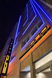 Soho Boutique Hotel's facade illuminated at night