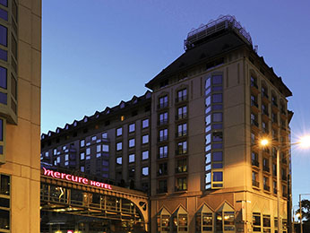 street view of Mercure Korona Hotel at dusk