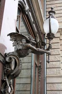 Demonic bronze lamp holder-
