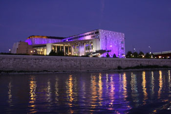 the Palace of Arts illuminated in purple at night