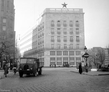 street view of the front facade of the Adria Palace with a red star on its top in the 1950s