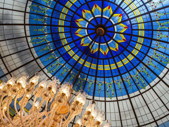 the stained-glass cupola in the Ritz Carlton Bp-royal blue, sky blue and yellow colourscolours