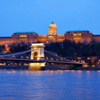 view of the Royal Palac ein Buda and the Chain bridge at the blue hour