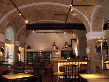 the vaulted brick walled interior of innio bar