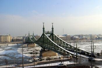 the snowcovered green Liberty bridge as seen from Gellert Hill