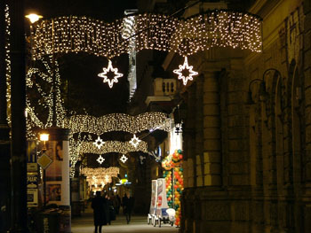 a street in downtown Budapest decorated with Xmas lights