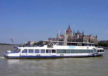a white tour boat on the Danube at the Parliament
