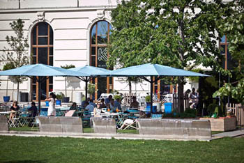 people sitting on the terrace of Kiosk with blue tents