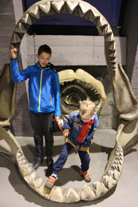 our 2 kids inside a giant shark jaw skeleton