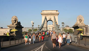 people walking on the Chain bridge in summer