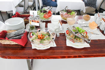 salads in round glass bowls on the buffet table
