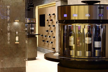 a modern wine dispensing machine in Cultivini and part of the interior