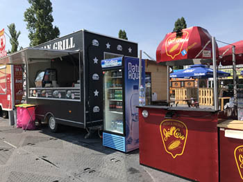 a black and wóred street food booth